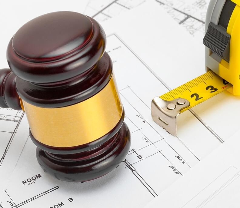 Gavel_and_contruction_plans_measuring_tape-340258-edited.jpg