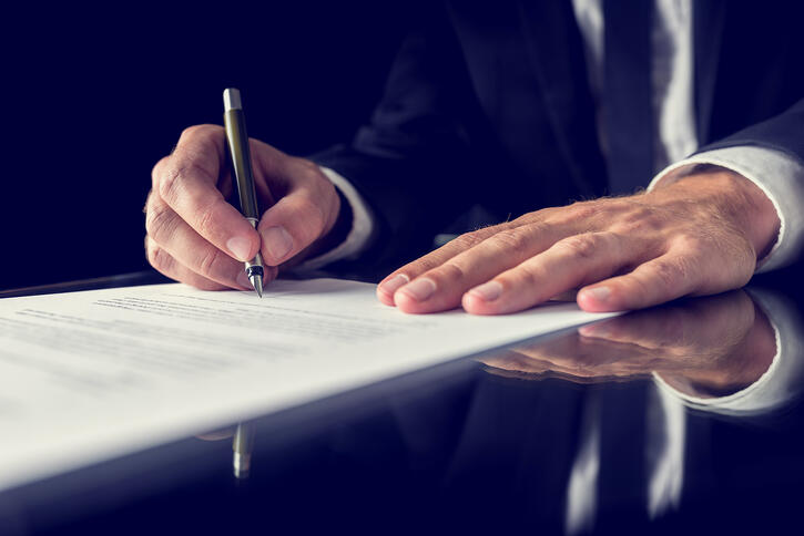 signing-legal-document-PSE9PFT